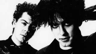 Lol Tolhurst and Robert Smith of The Cure, posed, studio portrait, 1983.