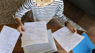 business woman paying bills