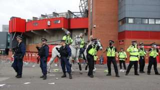 Police horses and officers outside Old Trafford