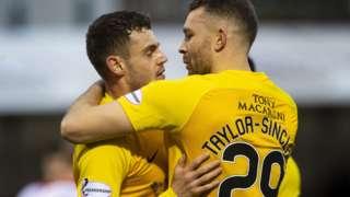 Livingston's Aaron Taylor-Sinclair (left) celebrates his goal