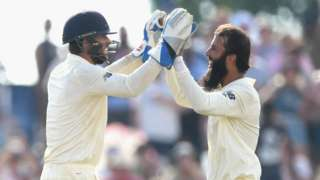 England's Ben Foakes and Moeen Ali