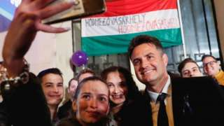 Opposition candidate for prime minister Peter Marki-Zay poses for a selfie with supporters