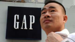 Man walks past Gap store in China