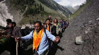 Indian Hindu pilgrims cross mountain trails during their religious journey to the Amarnath cave