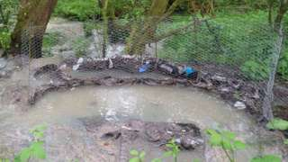 Sewage discharging from a manhole cover