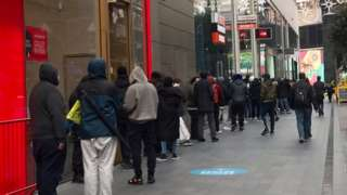 Customers queue for click and collect