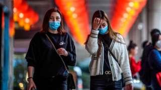 Pedestrians wear facemasks in Macau