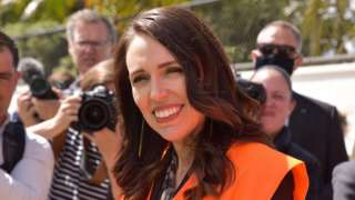 """New Zealand Prime Minister Jacinda Ardern (L) visits a building site to announce Labour""""s housing policy during campaigning in Auckland, New Zealand,"""