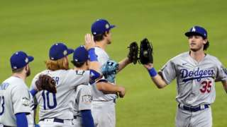LA Dodgers players celebrate after winning game three of the World Series