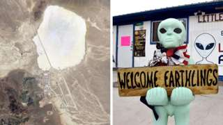 A satellite image of Area 51 and an alien-like statue outside a hotel in Rachel, Nevada