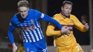 Kilmarnock's Luke Hendrie (left) battles for the ball against Motherwell's Scott McDonald