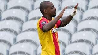 Lens and DR Congo's Gael Kakuta celebrating a goal