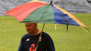 Paul Farbrace with an umbrella