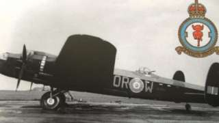 Lancaster and 61 Squadron badge