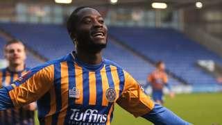 Daniel Udoh celebrates