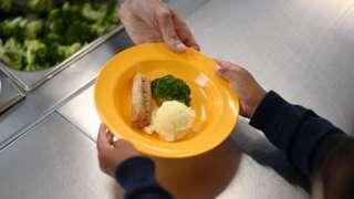 Pupil handed plate of food