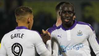Dwight Gayle and Mo Diame celebrate
