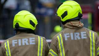 Fire fighters attend a fire in premises on the Walworth Road