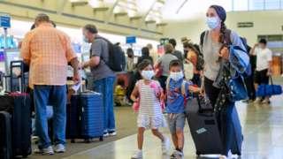 Passengers at John Wayne Airport in Santa Ana, CA