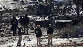 Investigators work near the site of an explosion in Nashville, Tennessee