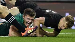 Jacob Stockdale scores Ireland's try despite Damian McKenzie's efforts to halt him