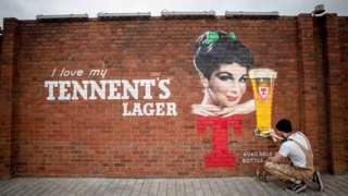 Tennent's lager graffiti on wall