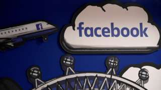 """Facebook branding is seen in a workspace at the company""""s offices in London"""