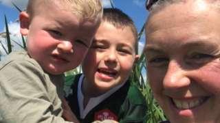 Janine Phillips and her children
