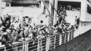 Jewish refugees aboard the MS St. Louis ocean liner wave as they arrive in Antwerp, Belgium.