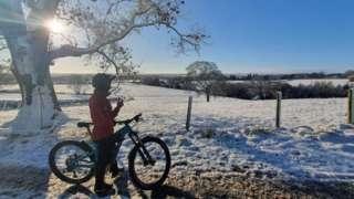 A cyclist on a snowy track