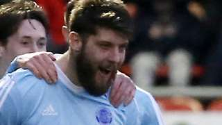 Will Evans celebrates a goal for Aldershot