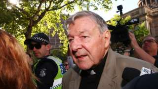 Cardinal George Pell outside a Melbourne court during his case in February