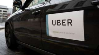 Uber logo on the side of a car