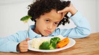 A child eating vegetables