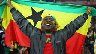 Man with a Ghana flag