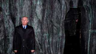 Vladimir Putin in front of the Wall of Grief memorial