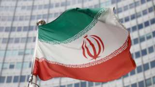 File photo showing flag of Iran flying in front of the headquarters of the International Atomic Energy Agency in Vienna, Austria