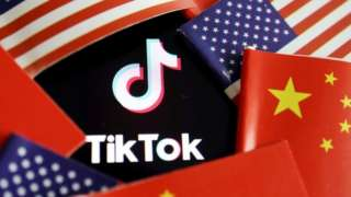 China and US flags are seen near a TikTok logo