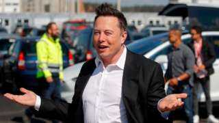 Elon Musk with palms outstretched