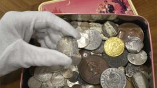 The New England shilling and the tin it was found in