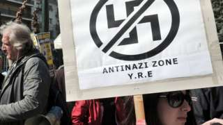 Anti-racist and anti-nazi activists gather outside the appeals court in Athens in 2013