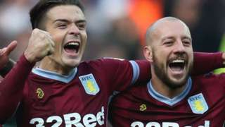 Jack Grealish and Alan Hutton celebrate