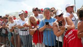 Trump supporters wait for the president in North Carolina, 2 August 2020