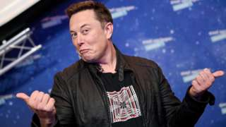 SpaceX owner and Tesla CEO Elon Musk arrives on the red carpet for the Axel Springer award, in Berlin, Germany, 01 December 2020