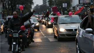 Newell's Old Boys fans parade to bring Messi home