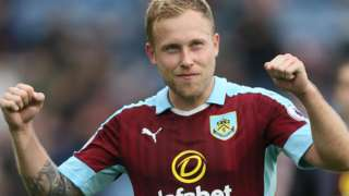 Scott Arfield celebrates Burnley's win