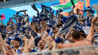 Finland supporters cheer during the UEFA EURO 2020 Group B football match between Finland and Belgium at Saint Petersburg Stadium in Saint Petersburg, Russia, on June 21, 2021