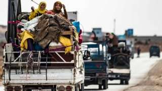 Families flee the border area near the town of Darbasiyah