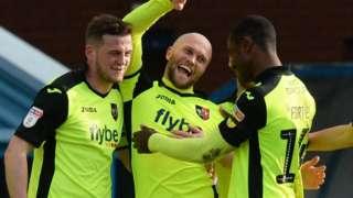 Exeter City celebrate a goal