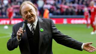 Gerry Marsden sings You'll Never Walk Alone before a Liverpool match against Blackburn Rovers at Anfield in 2010